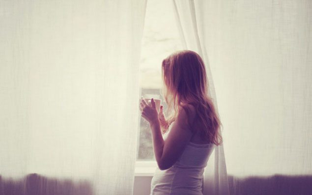 young-girl-looking-through-window-814286